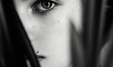 grayscale photo of woman s face